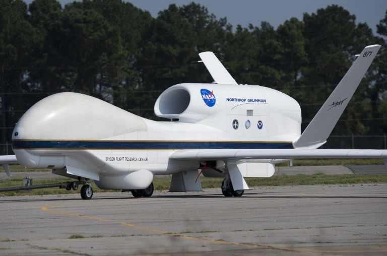 A NASA Global Hawk unmanned aerial vehicle, or drone aircraft, is towed after landing during a Hurricane and Severe Storm Sentinel, or HS3, mission at NASA's Wallops Flight Facility in Wallops Island, Virginia, on September 10, 2013. The HS3 mission uses two of the unmanned aircraft to fly over tropical storms and hurricanes to monitor weather conditions, utlilizing the  Global Hawk's ability to fly as high as 19.8 km (12.3 miles), as far as 20,278 km (12,600 miles) and stay in the air for as long as 28 hours. AFP PHOTO / Saul LOEB